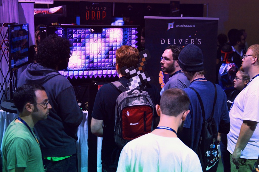 Gamers playing the demo of Delver's Drop at PAX Prime 2012